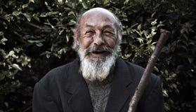 Vieux sans-abri heureux Photos stock