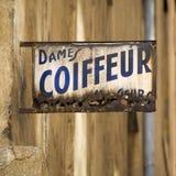 Vieux signe de Coiffeur en France Photo stock