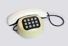 Vieux téléphone à bouton-poussoir en plastique Image libre de droits