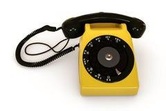 Vieux téléphone d'isolement sur le fond blanc Images libres de droits