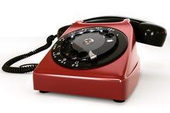 Vieux téléphone d'isolement sur le fond blanc Photographie stock libre de droits