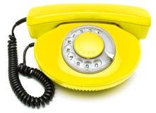 Vieux téléphone jaune Image stock