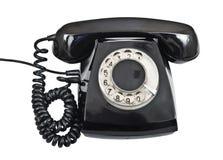 Vieux téléphone noir d'isolement Photos stock
