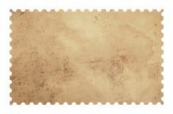 Vieux timbre vide grunge de papier d'affranchissement sur le blanc Image libre de droits
