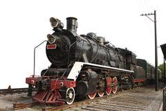 Vieux train de vapeur sur le fond d'isolement Photographie stock