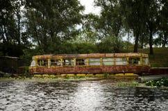 Vieux tram dans l'eau à Chernobyl Image stock