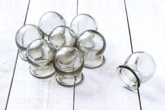 Vieux verre mettant en forme de tasse médical image stock