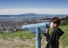 View. A young boy looks through the viewfinder Stock Photos