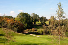 View of an 18th golf green in autumn. View of the 18th green on a golf course in England in autumn Royalty Free Stock Images