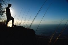 The view. Man at the top of a mountain with a volcano at the background Stock Photography