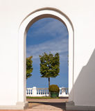 View. Through the arc of entrance to the balustrade of Monplaisir garden in Petrodvorets, Russia Stock Images