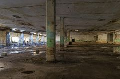 Abandoned industrial building. Wrecked interior. royalty free stock image