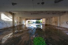 Abandoned industrial building. Wrecked interior. View of an abandoned building. Empty, wrecked recked industrial interior royalty free stock photo