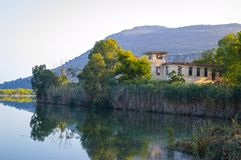 Abandoned hotel at Kaiafas lake, western peloponnese - Greece. View of an abandoned hotel in the islet of Kaiafas lake at western peloponnese - Greece royalty free stock photos