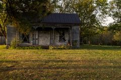 Abandoned House in Late Evening - Kentucky. A view of an abandoned house with barren clapboard siding in the late evening in central Kentucky royalty free stock photo
