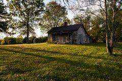 Abandoned House in Late Evening - Kentucky. A view of an abandoned house with barren clapboard siding in the late evening in central Kentucky stock photography