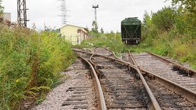 View of abandoned old railways in summer windy day stock video footage