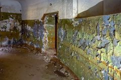 Abandoned old room with peeling paint. View of abandoned old room with peeling paint royalty free stock images
