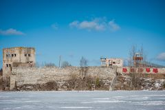 View of abandoned prison located in small lake with blue clear water in Rummu, Estonia. royalty free stock images