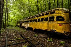 Abandoned Vintage Trolley / Streetcar - Pennsylvania. A view of an abandoned, vintage trolley / streetcar tucked in the woods of Pennsylvania Royalty Free Stock Photos