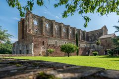 View of the Abbey of San Galgano from the right side with part of the reconstructed cloister stock photo