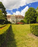 View on abbots palace and flowers in gdansk oliva park. Royalty Free Stock Image