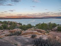 Sunset over Abiquiu Lake in Northern New Mexico. View of Abiquiu Lake and the mountains in northern New Mexico as seen from above the campground royalty free stock photo