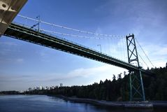 View Aboard a Cruise Ship as it Approaches Lions Gate Bridge in Historical Crossing royalty free stock photo