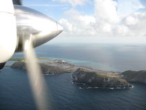 View from above. Airial View from small airplane down to carribean island Stock Photography