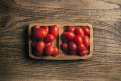 View from above of baby tomato on wood Royalty Free Stock Photo