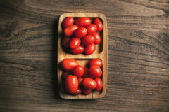 View from above of baby tomato on wood Stock Photo