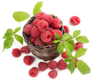 View from above of   basket with fresh raspberries. Top view of raspberries with leaves  in little  basket Stock Image