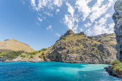 Turquoise blue sea in front of the Torrent de Pareis royalty free stock photos
