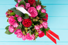 View from above on beautiful bouquet of pink and red roses with Stock Image