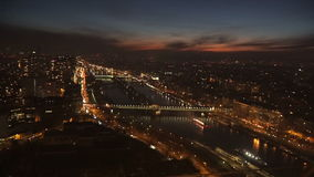 A view from above of a boat passing by the Seine at night. View from the eiffel tower to the sailing boats on the Seine at night stock video footage