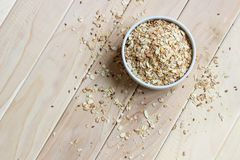 View from above. A bowl of muesli on a wooden background with sc stock photos
