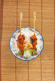 View from above on a bowl of rice with pork satay Stock Photography