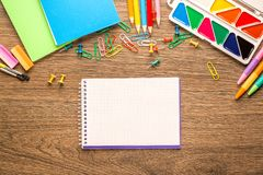 Bright school accessories, stationery on a wooden background. View from above stock photography