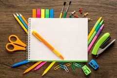 Bright school accessories, stationery on a wooden background. View from above royalty free stock photography