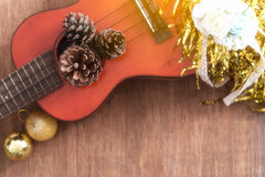 View from above Christmas background with pine corns and ukulele Royalty Free Stock Photography