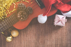 View from above Christmas background with pine corns and ukulele Stock Photos
