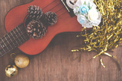 View from above Christmas background with pine corns and ukulele Stock Image