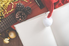 View from above Christmas background with pine corns and ukulele Royalty Free Stock Photo