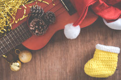 View from above Christmas background with pine corns and ukulele Stock Images