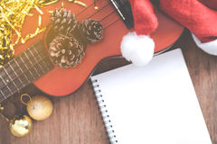 View from above Christmas background with pine corns and ukulele Royalty Free Stock Photos