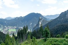 View from above on the city in the valley between the mountain ranges stock photography