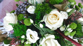 View from above, close-up, the floral composition consists of eucalyptus, solidago, Rose of avalanche, Santini , Eustoma. Flowers, bouquet, rotation on white stock video footage