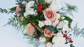 View from above, close-up, flowers, bouquet, rotation, consists of rose cappuccino, snowflake rose, rose yana creamy. Plamosus, eucalyptus solidago Rose of stock video