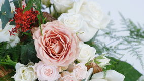 View from above, close-up, Flowers, bouquet, rotation, consists of Rose cappuccino, Snowflake rose, Rose yana creamy. Flowers, bouquet, rotation on white stock video footage