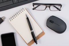 View from above  close up. Office supplies and computer devices. Royalty Free Stock Photos